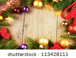 Christmas background with balls and decorations over wooden table - stock photo