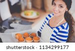 woman is making cakes in the... | Shutterstock . vector #1134299177