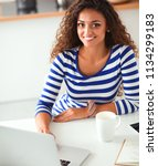 smiling young woman with coffee ... | Shutterstock . vector #1134299183