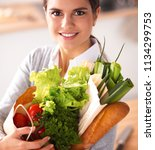 young woman holding grocery... | Shutterstock . vector #1134299753