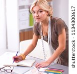 young fashion designer working... | Shutterstock . vector #1134300617