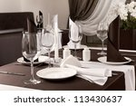 laid the table at restaurant | Shutterstock . vector #113430637