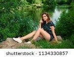 beautiful girl in denim shorts... | Shutterstock . vector #1134330857