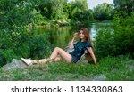 beautiful girl in denim shorts... | Shutterstock . vector #1134330863