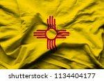 new mexico 3d wrinkled flag...   Shutterstock . vector #1134404177