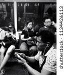 commuters inside a packed mrt... | Shutterstock . vector #1134426113