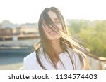 young carefree woman with dark... | Shutterstock . vector #1134574403