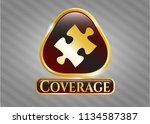 gold shiny emblem with jigsaw... | Shutterstock .eps vector #1134587387