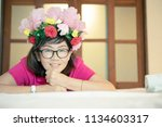 asian woman with artificial... | Shutterstock . vector #1134603317