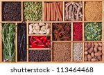 spices and herbs in wooden box - stock photo