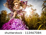 Dramatized image of sensual girl symbolizing autumn. Art Fashion outdoor photo. - stock photo