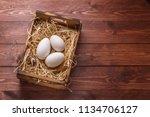 three big fresh goose eggs in a ... | Shutterstock . vector #1134706127