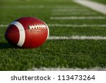 American Football on the Field near the hashmarks or yard lines - stock photo