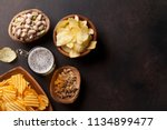 lager beer and snacks on stone... | Shutterstock . vector #1134899477