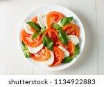 close up photo of caprese salad ... | Shutterstock . vector #1134922883