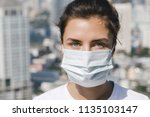 woman wearing face mask because ... | Shutterstock . vector #1135103147