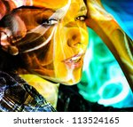 beautiful young girl poses face art close up - stock photo