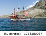 a pirate ship with tourists... | Shutterstock . vector #1135280087