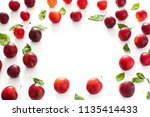 red and yellow plums pattern on ... | Shutterstock . vector #1135414433