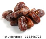 A heap of high-quality dates on a white background with a light shadow. The fruit is closely associated with Islam. - stock photo