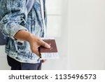 closeup of man holding... | Shutterstock . vector #1135496573