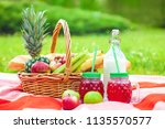 picnic basket  fruit  juice in... | Shutterstock . vector #1135570577