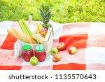 picnic basket  fruit  juice in... | Shutterstock . vector #1135570643