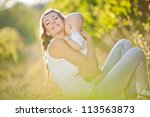 mother and baby in park portrait | Shutterstock . vector #113563873