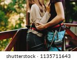 faceless side view of couple... | Shutterstock . vector #1135711643
