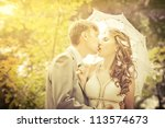 groom and bride in a park.... | Shutterstock . vector #113574673