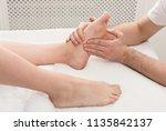leg massage. physiotherapist...   Shutterstock . vector #1135842137