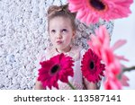 Fashion baby face beautiful child with fair hair in a pink dress flowers paper invoice background - stock photo