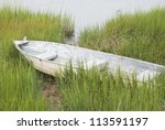 Fishing Boat In Tall Grass On...