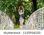 student schoolgirl happy with... | Shutterstock . vector #1135926233