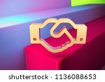 golden handshake icon on the... | Shutterstock . vector #1136088653