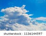 big cumulus cloud in sunlight... | Shutterstock . vector #1136144597