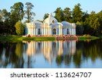 pavilion on lake in Pushkin park St. Petersburg Russia at sunset light - stock photo