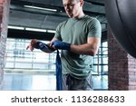 spacious gym. good looking... | Shutterstock . vector #1136288633