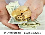 banknotes and bitcoins in male...   Shutterstock . vector #1136332283