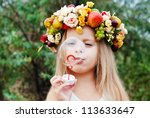 Small photo of Happy Child in Summer. Beautiful Girl with Flowers Wreath from Flowers blows Soap Bubbles. Happy Children. Healthy Kids. Spring Time.