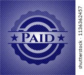 paid badge with denim texture | Shutterstock .eps vector #1136362457