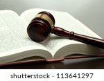 Wooden Gavel And Book On Woode...