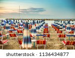 sunshades and deck chairs of... | Shutterstock . vector #1136434877