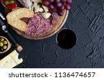 bottle of wine with wine glass... | Shutterstock . vector #1136474657