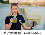 pretty blonde girl with glass... | Shutterstock . vector #1136482277