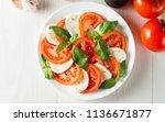 close up photo of caprese salad ... | Shutterstock . vector #1136671877