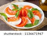 close up photo of caprese salad ... | Shutterstock . vector #1136671967