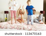 family relaxing together in bed | Shutterstock . vector #113670163