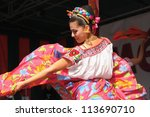 BRUSSELS, BELGIUM-SEPTEMBER 15: Dancer of Xochicalli Mexican folkloric ballet performs in a concert on Grand Place during 12 edition of Folklorissimo Festival on September 15, 2012 in Brussels. - stock photo