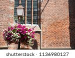 light pole with flowers in... | Shutterstock . vector #1136980127